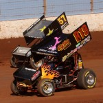 HARD CHARGERS: Jac Haudenschild (r19) and Shane Stewart navigate The Dirt Track Saturday afternoon. (Dick Ayers Photo)