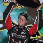 CLEAN SWEEP: Jason Meyers hoists his trophy after winning the 2010 World of Outlaws Sprint Car Series championship Saturday night at The Dirt Track at Charlotte Motor Speedway in Concord, N.C. (Justin Leedy Photo)