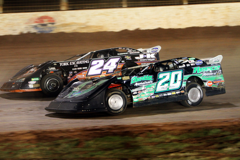 Jimmy Owens (20) fights his way past Rick Eckert en route to winning the season-ending World Finals Nov. 6 at The Dirt Track at Charlotte. (Rhonda McCole Photo)