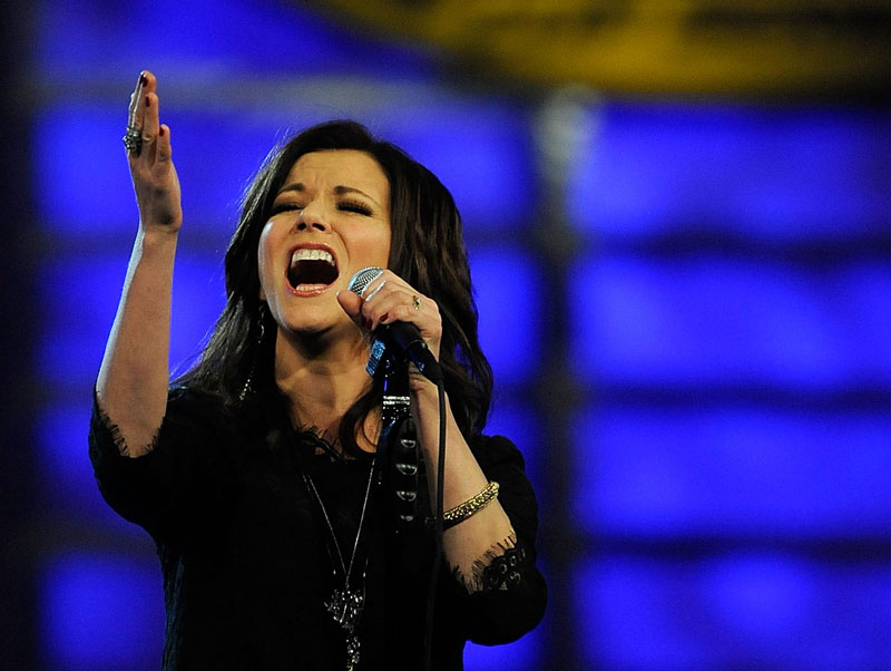 "SING IT, SISTER: Martina McBride hits a high note during her rendition of ""America The Beautiful"" during the 2010 NASCAR Sprint Cup Series Awards Ceremony Thursday at Wynn Las Vegas. (Rusty Jarrett/Getty Images Photo)"