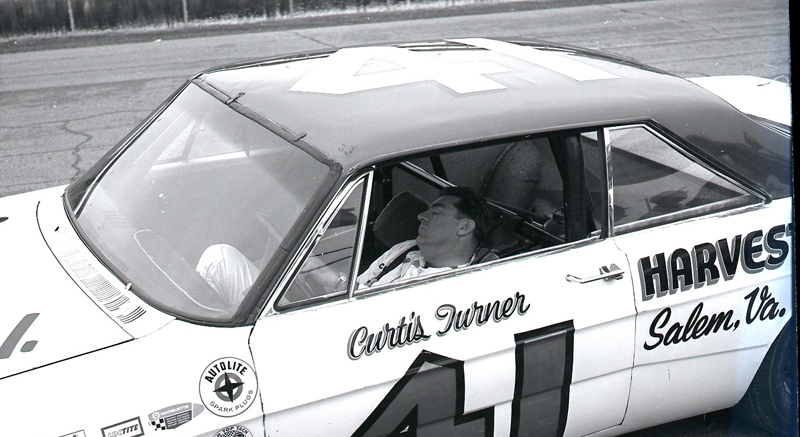 Curtis Turner sleeps behind the wheel of his NASCAR stock car during the 1966 version of Speedweeks at Daytona Int'l Speedway.