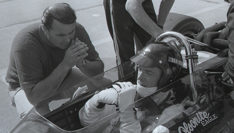 Dan Gurney sits in his Olsonite Eagle Indy car during practice for the 1968 Indianapolis 500 at Indianapolis Motor Speedway.