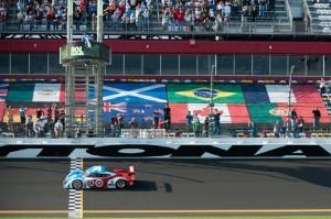 Scott Pruett takes the checkers to win the Rolex 24 At Daytona. (Scott LePage/MotorRacing Photo)