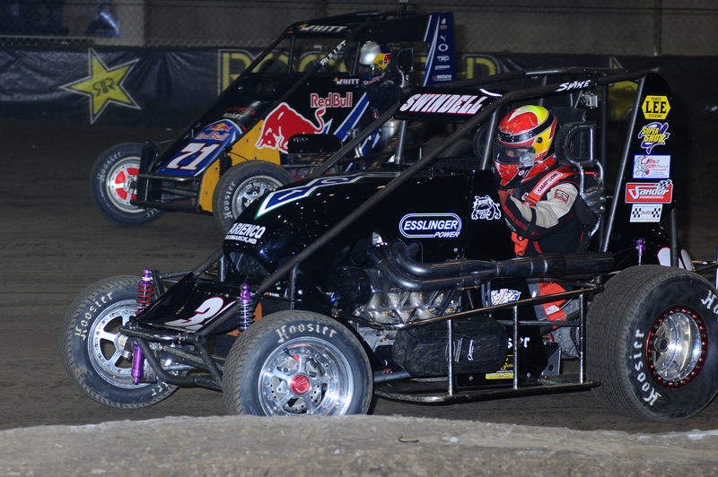 Despite minor damage in his heat race, Kevin Swindell (39) raced his way to victory lane on the second night of the Chili Bowl Nationals and a transfer into Saturday's championship feature. (John DaDalt Photo)