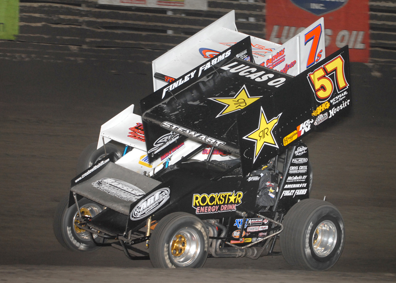Shane Stewart (57) races Dustin Selvage in the 360 Nationals feature Aug. 7 at Knoxville (Iowa) Raceway. (Frank Smith Photo)