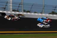 BEACH PARTY: The No. 6 Michael Shank Racing with Curb/Agajanian Ford Dallara leads the No. 1 Chip Ganassi Racing with Felix Sabates BMW Riley and the No. 59 Brumos Racing Porsche GT3 around Daytona Int'l Speedway during the Roar Before the Rolex 24 three-day test session for the Grand Am Rolex Series Jan. 7-9. (Scott LePage Photo)
