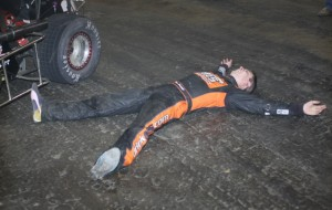 Kevin Swindell celebrates after holding off father Sammy to become the first back-to-back winner in the 25-year history of the Lucas Oil Chili Bowl. (Don Holbrook Photo)