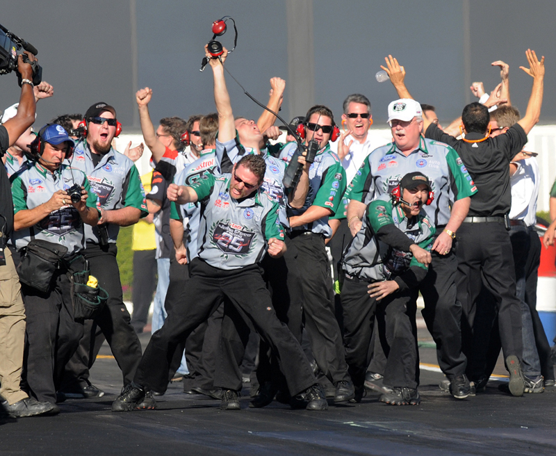 John Force's team celebrates its championship-clinching round win at the NHRA Finals in November. (Angela Barraza Photo)