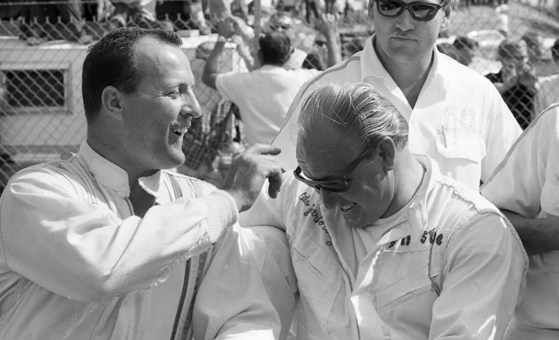 Racing champions A.J. Foyt (left) and Cale Yarborough enjoy a playful moment prior to the October 1966 NASCAR Grand National race at Charlotte Motor Speedway.