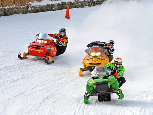 SNOWY SHARON: The Ohio State Snowmobile Ass'n took over Sharon Speedway Saturday as more than 100 snowmobilers hit the Ohio speedplant's snow-covered course. (Joe Secka/JMS Pro Photo)