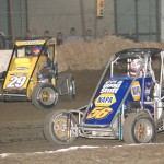 Andrew Deal (56) battles Brandon Hahn during ASCS Chevy Ecotec Midget action.