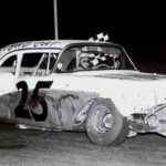 With checkered flag in hand, Bryant Tucker begins his victory lap after scoring  a feature win at Chicago's Soldier Field in 1961. For the second straight year, Tucker was the late-model stock car champion at the lakefront arena. (Wayne Bryant Photo/Ted Knorr Collection)