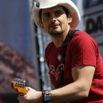 GUITAR LICKS: Country music singer Brad Paisley performs a pre-race concert for fans Sunday at Daytona Int'l Speedway. (HHP/Harold Hinson Photo)