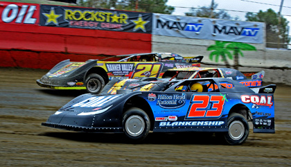 THREE AMIGOS: Brian Birkhofer (23x), Dan Stone (21d) and Billy Moyer, Jr. roll out of turn two three wide during the Lucas Oil Late Model Dirt Series makeup feature Friday morning at East Bay Raceway Park. (Joe Secka/JMS Pro Photo)