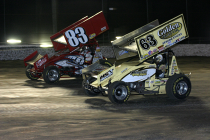 SIDE BY SIDE: Tim Shaffer (83) and Chad Kemenah race head to head for position during Friday night's World of Outlaws Sprint Car Series feature at Florida's Volusia Speedway Park. (Todd Ridgeway Photo)