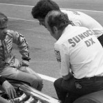 Mark Donohue (left) talks with crew members on pit road.