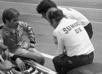 Al Unser (left), Mark Donohue (center) and Bobby Unser chat on pit road before the 1973 Schaefer 500.