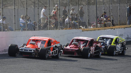 NOSE TO TAIL: Burt Myers (1) leads Justin Loftin (23) and eventual winner George Brunnhoelzl III during Sunday's season-opening NASCAR Whelen Southern Modified Tour Spring Classic 150 at Caraway Speedway in Asheboro, N.C. (Getty Images Photo)
