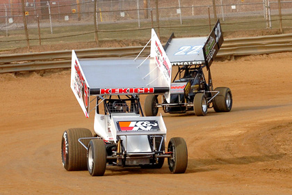 DOWN AND DIRTY: Adam Kekich (5) holds off Brandon Spithaler during a practice session for sprint cars at Pennsylvania's Mercer Raceway Park. (Hein Brothers Photo)