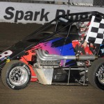 The midget car Donnie Ray Crawford III was scheduled to drive Saturday at the Chili Bowl Nationals makes a ceremonial lap of Tulsa (Okla.) Expo Raceway. Crawford was killed Saturday morning in a family dispute. (Frank Smith photo)
