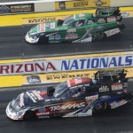 John Force (far lane) lost to his daughter Courtney in the first round of Funny Car eliminations Sunday at Firebird Int'l Raceway. (NHRA photo)