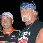 Billy Moyer (left) chats with famed wrestler and actor Hulk Hogan Saturday at Bubba Raceway Park. (Al Steinberg photo)