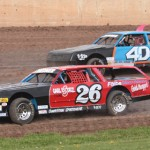 Scott Reidner (26) and his son Brandon race for position in street stock competition at Beaver Dam Raceway in Wisconsin. (Bob Cruse photo)