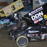 Shane Stewart (3g) races under Matt Linder at Ohio's Fremont Speedway. (Action photo)