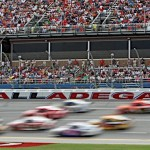 NASCAR Sprint Cup Series cars are a blur as they pass by fans in the grandstands at Talladega (Ala.) Superspeedway. (HHP/Alan Marler Photo)