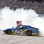 Brad Keselowski celebrates his second NASCAR Sprint Cup Series triumph at Talladega (Ala.) Superspeedway after winning the Aaron's 499 earlier this season. (HHP/Alan Marler Photo)