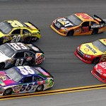 Michael Waltrip (55), Landon Cassil (83) and Joey Logano (20) lead a pack of three-wide racing during the Aaron's 499 Sunday at Talladega (Ala.) Superspeedway. (HHP/Brian Lawdermilk Photo)