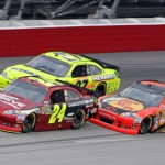 Jeff Gordon (24) battles Paul Menard (27) and Jamie McMurray for position during the NASCAR Sprint Cup Series Souther n500 at Darlington (S.C.) Raceway. (HHP/Alan Marler Photo)