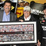 NASCAR President Mike Helton (right) presents Rick Hendrick (center) with a special framed image celebrating the 200th victory for Hendrick Motorsports in the NASCAR Sprint Cup Series. (HHP/Harold Hinson Photo)