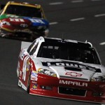 Jimmie Johnson leads Kyle Busch during the NASCAR Sprint All-Star Race at Charlotte Motor Speedway. (HHP/Brian Lawdermilk Photo)