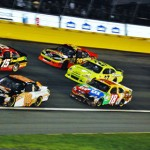 Dale Earnhardt, Jr. (88) and Clint Bowyer (15) lead a pack of cars during the NASCAR Sprint All-Star Race. (Justin Leedy Photo)