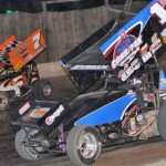 Jessica Zemken races under Sparky Lowe during Empire Super Sprints action at New York's Fonda Speedway earlier this season. (Harry Cella photo)