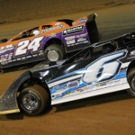 Steve Shaver (6) works past Rick Eckert en route to a $10,000 pay day at Virginia Motor Speedway. (Al Goulder photo)