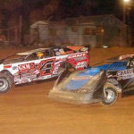 The battle for the lead position in the Late Model feature as Jared Miley (H1) and John Garvin Jr. (4) slug it out for the first nine laps before Miley went on to win the event at Pennsylvania's Lernerville Speedway. (Hein Brothers photo)