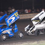 Ray Allen Kulhanek (21) races away from Logan Bledsoe during ASCS Gulf South action at Battleground Speedway. (RonSkinnerPhotos.com photo)
