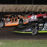 Scott Bloomquist (0) races under Tyler Reddick (11) and Brad Neat during Lucas Oil Dirt Late Model Series action at Tri-City Raceway in Illinois. (Don Figler photo)