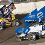 Butch Schroeder (20) races J.R. Stewart during sprint car action at Limaland Motorsports Park in Ohio. (Mike Campbell photo)