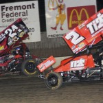 Dale Blaney (2) races under Bryan Sebetto on his way to sweeping All Star sprint car features at Ohio's Fremont Speedway. (Julia Johnson photo)