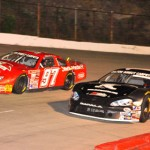 Daniel Pope II (16) and Zeke Shell (97) race side-by-side between turns three and four at Kingsport (Tenn.) Speedway. (Randall Perry photo)