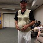 NASCAR driver Kevin Harvick wearing a pregnancy suit...if you look close it almost looks like Homer Simpson.