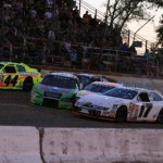 Larry Barford Jr. (green with center stripe) drives toward Chris Buescher (17) on the final lap of the Akona 200 presented by Federated Car Care at Minnesota's Elko Speedway, sandwiching Tom Hessert (52) as Frank Kimmel sneaks by. (ARCA Racing Series Photo)