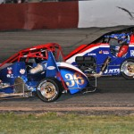Jimmy Anderson (36) takes the lead from Kyle O'Gara during STARS/USAC midget competition at Grundy County Speedway in Morris, Ill. (Phil Rider photo)