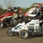 Bobby East (4), Jimmy Simpson (21) and Steve Buckwalter go three-wide during the Indiana Midget Week opener at Gas City I-69 Speedway. (David E. Heithaus Photo)