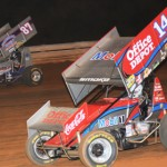 Tony Stewart (14) chases Alan Krimes during All-Star sprint car competition at Williams Grove Speedway in June. (Julia Johnson photo)