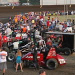 Cars and teams line up in the infield prior to Sunday night's non-winged sprint car race at Indiana's Kokomo Speedway. (Gordon Gill Photo)