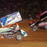 Eventual sprint car winner Brian Ellenberger (20) chases Eric Williams at Pennsylvania's Lernerville Speedway. (Hein Brothers photo)